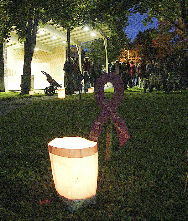 Participants share tales of torment, hope during domestic violence vigil