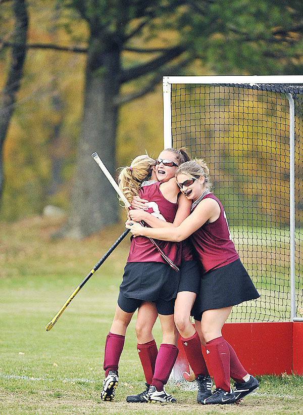 Foxcroft Academy teammates Kelsy Boss, left, and Mariah Arno, right, give a congratulatory hug to Sabrina Sharrow after she scored the winning goal in overtime of their game versus Central in East Corinth on Wednesday.  Buy Photo