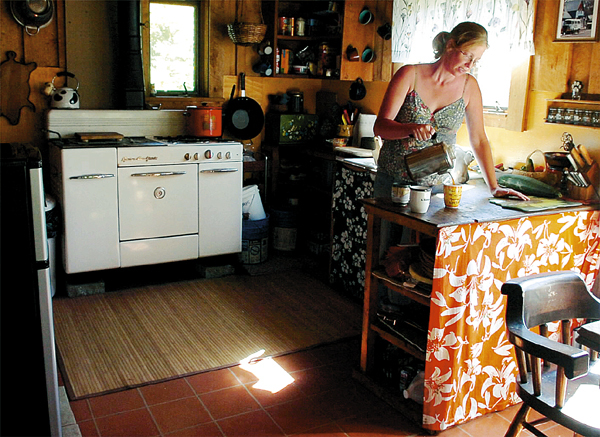 Kim Paradis and her husband Mike live completely &quotoff the grid&quot in their Fort Kent home, relying on solar and wind energy to generate electricity.   Buy Photo
