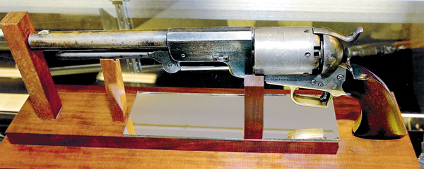 This circa 1840s  .44-caliber Colt Walker pistol sold for $800,000 at Julia's Auction in Fairfield, Maine on Tuesday, Oct. 7, 2008, during a firearms auction. Owner John McBride of Libby, Mont.,  waved his cowboy hat and yelled in delight after an anonymous bidder bought the pistol.  The pistol was made for U.S. marshals and belonged to the University of Maine graduate's great-great-uncle.   &quotWe did better than we expected,&quot McBride said with a big smile.