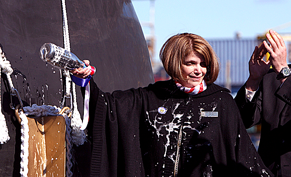Anna Mae Meyer grimaces as champagne splashes on  her during the christening ceremony of the Wayne E. Meyer , the 505-foot-long warship docked in the Kennebec River at Bath Iron Works shipyard, in Bath, Maine, on Saturday, Oct. 18, 2008. The retired rear admiral known as the &quotfather of Aegis&quot was the guest of honor as a Navy Aegis destroyer bearing his name was christened. The Meyer represents the 58th destroyer in the class and the 31st built at Bath Iron Works.