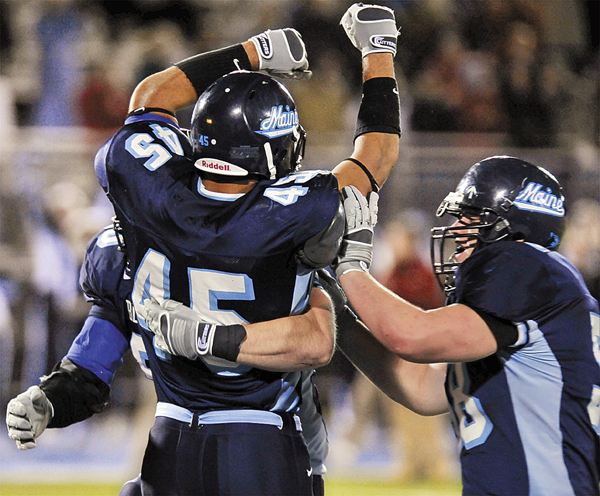Maine fullback Jared Turcotte, (45), celebrates his touchdown run in the second overtime of their game against Hofstra with teammates Matthew Barber, (50), and Steven Shea, (58), of their NCAA football game in Orono, Maine, Saturday, Oct. 18, 2008.
