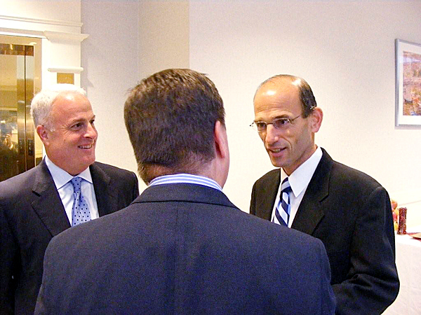 Gov. John Baldacci, right, talks with Boston Finannciual Data Services Inc. President and Chief Executive Officer Stephen Hooley, center, and Executive Vice President and Chief Operating Officer Terry Metzger, left, at the ribbon-cutting for the company's newly opened service operation center in Rockland Wednesday.  Buy Photo