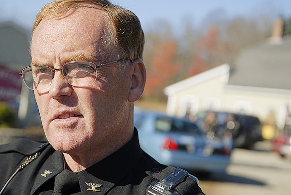 At a police staging area off Route 1 in Searsport, Searsport Police Chief Richard H. LaHaye Jr. speaks to the media regarding Randall Hofland, who remained at large Friday morning after bran-dishing a firearm and threatening officers during a vehicle safety check on Route 1 in Searsport Thursday night. Buy Photo