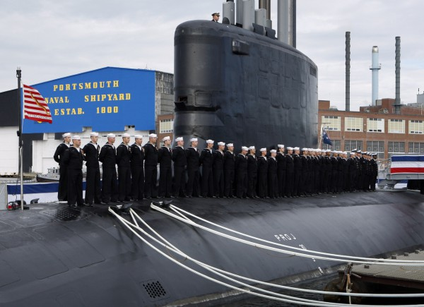 Sailor line the deck during the commissioning of the USS New Hampshire, a Virginia-class nuclear submarine, at the Portsmouth Naval Shipyard, Saturday, in Kittery, Maine.