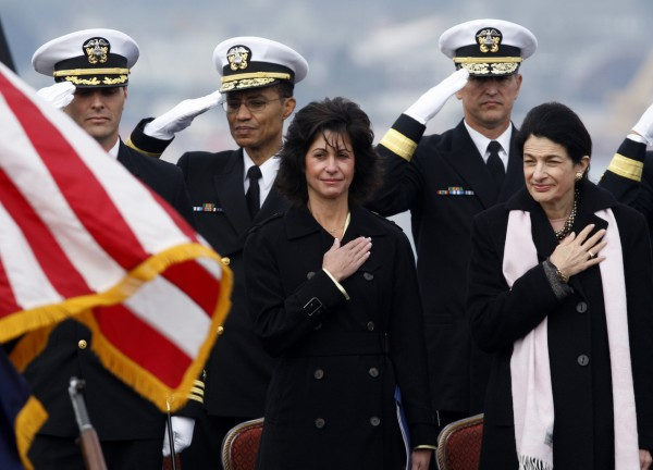 Cheryl McGuinness of Portsmouth, N.H., center, whose late husband was a co-pilot on one of the planes that crashed into the World Trade Center, stands next to Sen. Olympia Snowe, R-Maine, during the commissioning of the Virginia-class nuclear submarine USS New Hampshire at the Portsmouth Naval Shipyard, Saturday, in Kittery, Maine. McGuinness is the submarine's sponsor.