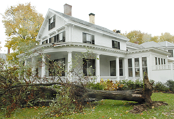 Sunday?s wind storm downed an ash tree at the Sykes family residence on 191 Broadway in Bangor. Their porch roof was damaged when the tree fell. The storm caused power outages and some property damage across the state. Buy Photo