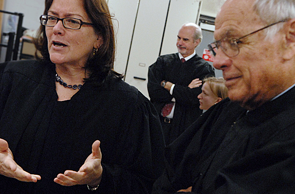 Chief Justice Leigh I. Saufley, left, Justice Andrew Meade, center, and Justice Robert Clifford, right, meet with other Maine Supreme Judical Court justices behind the scenes at Bangor High School before hearing oral arguments in several cases there Wednesday, October 29, 2008.  The Court's visit to Bangor is one of several stops to high schools in the state to help students understand how the court system works.  Buy Photo