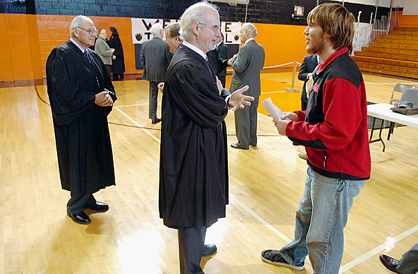 Machias Memorial High School senior Shawn Kelley (right), 17, who is considering a law career, chats with Justice Andrew W. Mead of the Maine Supreme Judicial Court at Shead High School in Eastport on Thursday. Justice Robert W. Clifford is at left.  Buy Photo