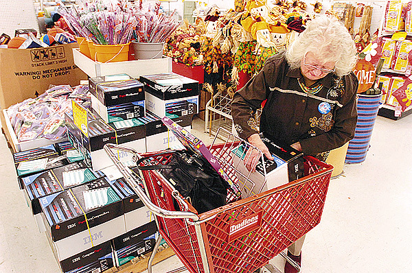 Florence Conley of Bangor fills her cart with bargain-priced items while shopping at Marden?s in Brewer on Sunday. ?I can?t go home without snacks,? said Conley, who shops at Marden?s to take advantage of bargain prices on snack items for her great-grandchildren?s after-school visits.
