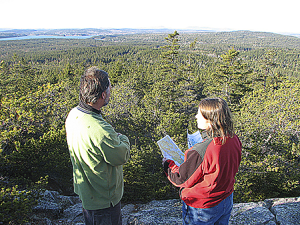 Victor Rydlizky (from left), a planner from Ellsworth, and Friends of Acadia Conservation Director Stephanie Clement take in the view Sunday while looking north from Schoodic Head in the Schoodic section of Acadia National Park. Rydlizky and Clement were among a dozen people who toured the park?s Schoodic section, on the eastern side of Frenchman Bay, to get a sense of the scope of a 3,300-acre resort development proposed for an abutting property just north of the park boundary.