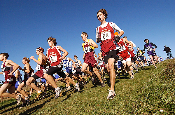 Runners jockey for position at the start of the Class B boys state cross country race in Belfast Saturday. Greely of Cumberland Center captured the state title.