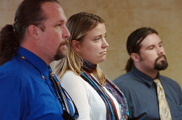 Christian Simpson (left) of Bethel, Crystal Stilwell of Bath and Bernard Beckwith of Poland stand before Judge Kevin Stitham in 13th District Court in Dover-Foxcroft on Monday, where they faced charges stemming from a naked dip into Moosehead Lake in the name of sandwich from the Black Frog Restaurant in Greenville last summer. Stitham found Stilwell not guilty in the naked dip case while Simpson and Beckwith were found guilty and each fined $200 plus a $50 court fee. Buy Photo