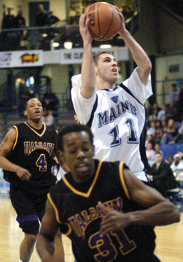 Maine's Jason Hight puts up a shot over Albany's Jason Hight (11) pulls up to fire a shot over Albany's Jamar Wilson during a 2005 game in Orono. Hight has had to call it quits as a player due to a rare nerve disorder.  Buy Photo