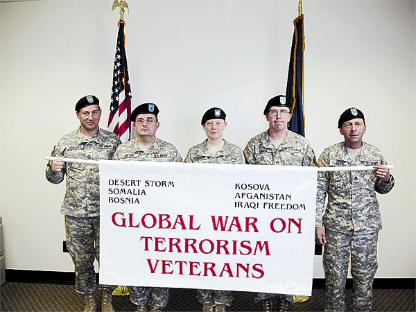 A contingent of veterans will participate in the Vesterans Day Parade on Tuesday, Nov. 11, in Brewer and Bangor.  Displaying the Global War on Terrorism Banner are (from left) Sgt. 1st Class Scott Crooker, CW2 Michael Rideout, Spec. Meaghan Howard, Sgt. Earl Davis and Sgt. 1st Class Gilman Theriault.