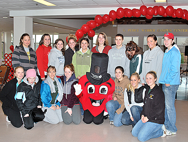 Heart Walk participants pose with American Heart Association Mascot &quotTicker&quot at the Heart Walk on Oct. 25 at Husson University in Bangor.