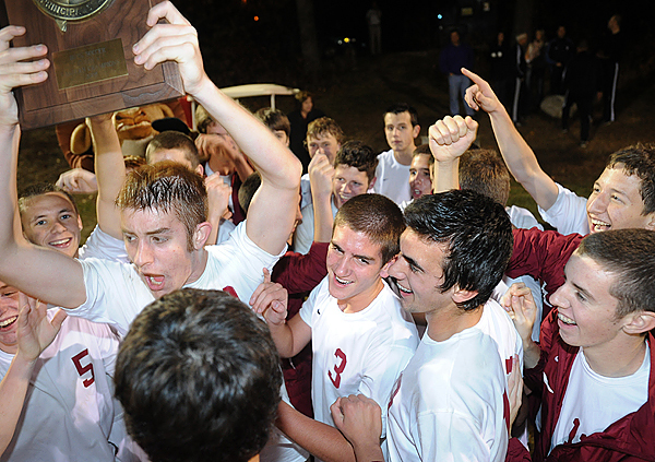 Bangor High School's boys soccer team celebrates after beating Brunswick High Schoo in the Eastern Maine Class A championship game in Bangor Wedesday.  Bangor won the title game 2-0. Buy Photo