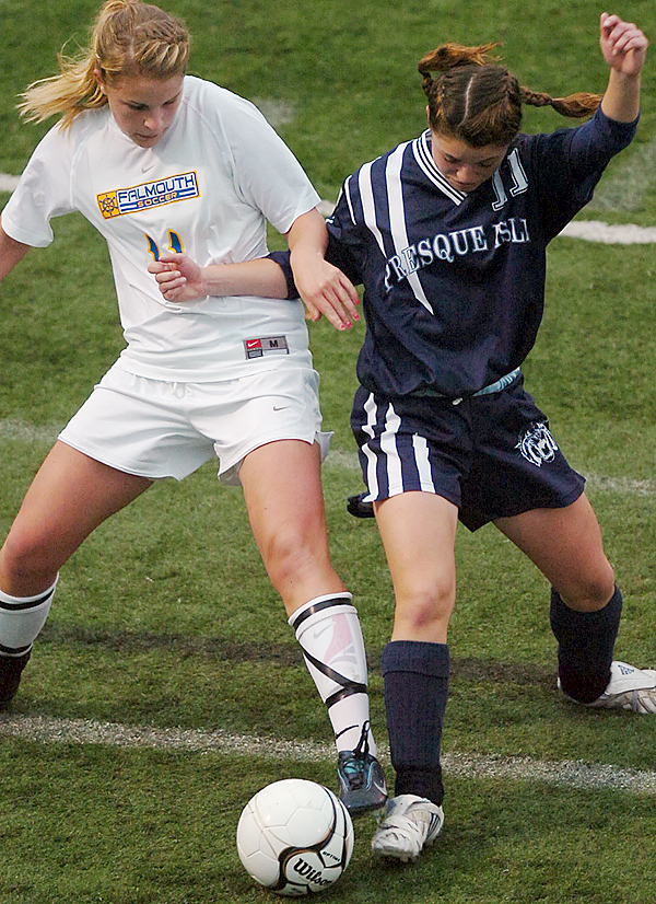 Kayla Richards of Presque Isle (right) battles Falmouth's Sarah Girouard for control of the ball during the first half of Saturday afternoon's Class B state championship game in Hampden.
