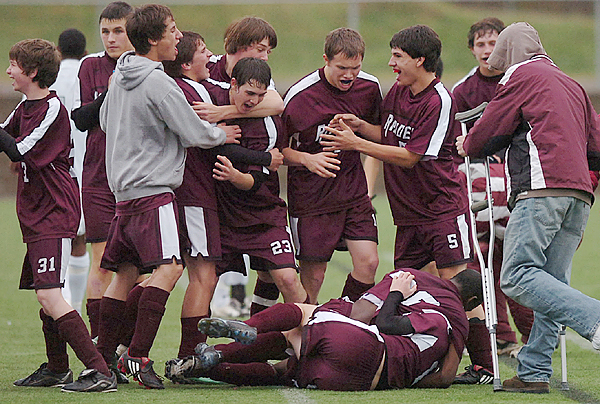 Washington Academy celebrates its 2-1 MPA Class C Maine State Championship soccer match over Waynflete School on Saturday at the Weatherbee School Athletic Complex in Hampden.