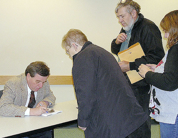 &quotLeave It To Beaver&quot star Jerry Mathers signs autographs for fans in Houlton Monday afternoon. The popular former child actor visited Houlton, Presque Isle and Fort Kent during the day as part of the &quotHelp Is Here Express&quot bus tour. At each stop, Mathers spoke about the effects of chronic disease to interested members of the public.  Buy Photo