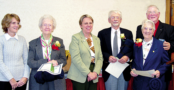 The Retired and Senior Volunteer Program presented 25 Years of Service Awards recently. Shown are (from left) Helen Pennington, Bangor Region Chamber of Commerce, presenting to Ruth Dougherty; Joyce Hedlund, Eastern Maine Community College, to Emile Amnotte; and Ralph Turner, RSVP Advisory Council member, to Clara Swan.