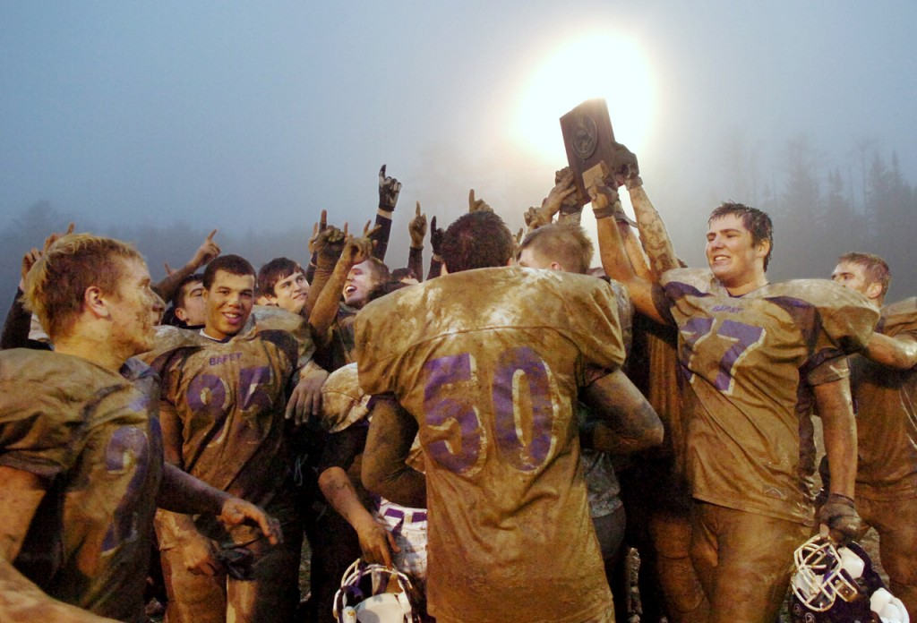 John Bapst players celebrate their 21-14 win over Bucksport Saturday for the Eastern Maine Class C championship.