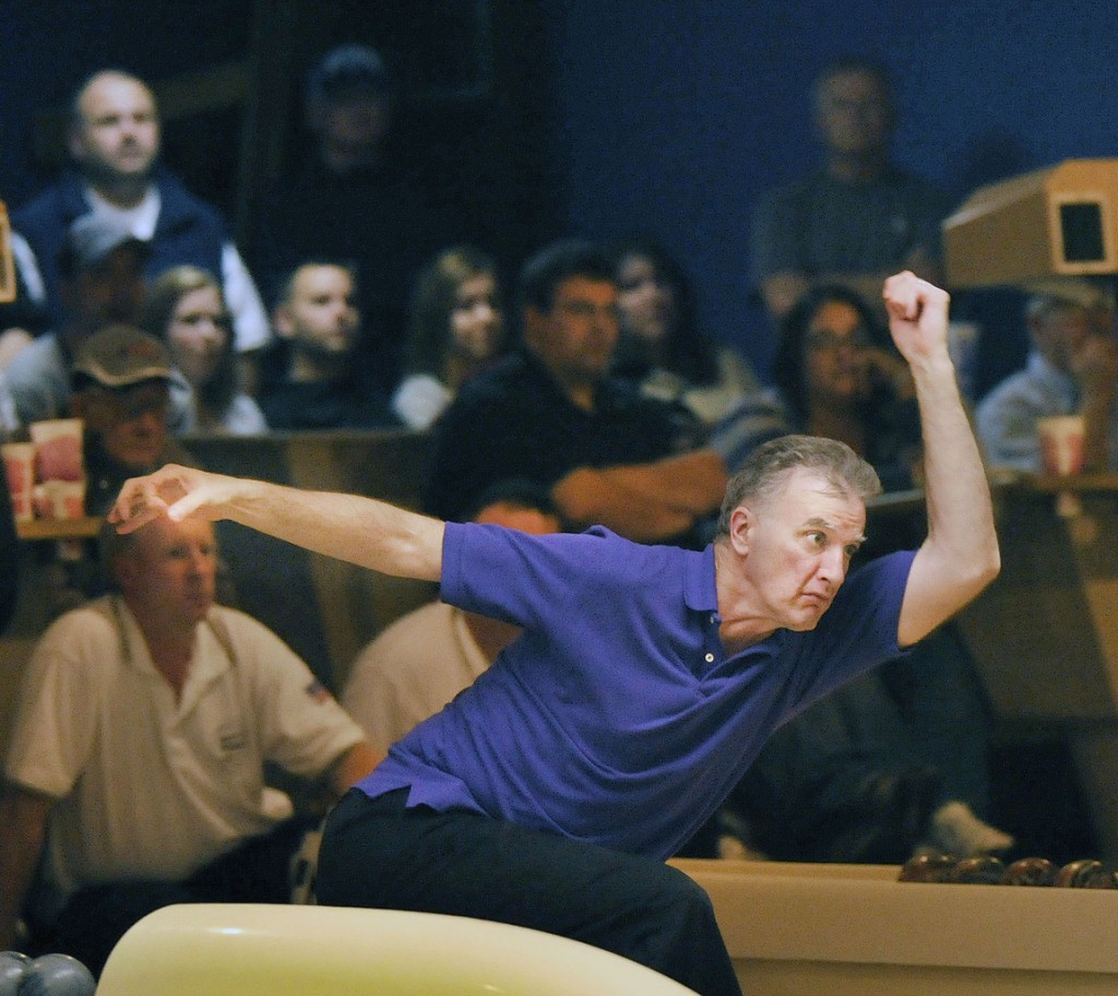 Peter Flynn bowls in the second string of the three string final for USA East  team versus Maria's Sub in the final round Saturday.