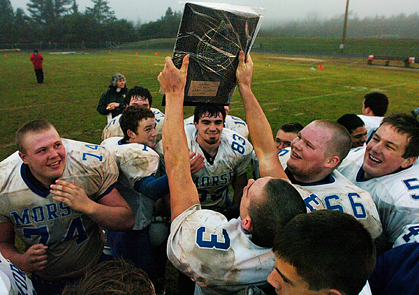 Members of the Morse High School football team celebrate  their win over Mt. Desert Island on the field at MDI High School on Saturday, November 15, 2008. Morse won 10-7.  Buy Photo