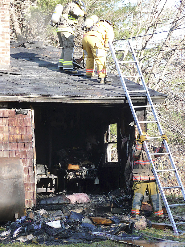 Firefighters from four towns battled a house fire at 27 River Road in Detroit on Monday.