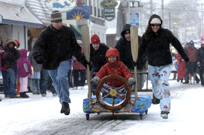 Members of the Thirsty Whale bed racing team, (L to R)  Basil Eleftheriou, Dan Norcross, Amy Gregory, Dan Ranzoni and Sarah Cline bolt up Cottage Street in Bar Harbor on Saturday, Nov. 22, 2008 during the Bar Harbor Chamber of Commerce First Annual Bed Race.  Buy Photo