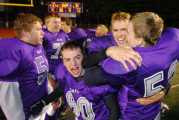 John Bapst celebrates its win over Winthrop 21-14 for the Class C state football championship at Fitzpatrick Stadium in Portland on Saturday. It's the team's first title since 1976.  Buy Photo