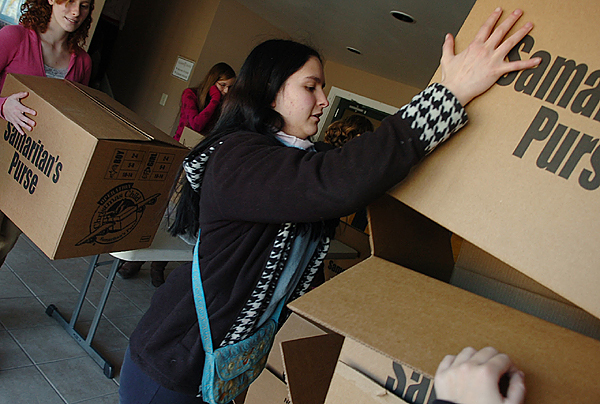 Monica Norris, a senior at Calvary Chapel Christian School in Orrington, stacks boxes that will be filled with presents as part of Operation Christmas Child. Both the school and Calvary Chapel Christian Church have been participating in the program, which was founded by the Rev. Franklin Graham in 1993 and distributes gifts to needy children around the world.  Buy Photo
