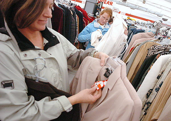 Kathy DeFazio,left, and her daughter April DeFazio, both of St. John, N.B. look over bargains in the clothing section of Marden's in Brewer Friday afternoon. They made the early morning pilgrimage to central Maine to take advantage of the Black Friday sales.  Buy Photo
