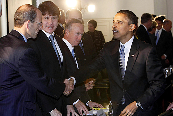President-elect Barack Obama (right) greets Maine Gov. John Baldacci (left) at the bipartisan meeting of the National Governor's Association at Congress Hall on Tuesday in Philadelphia. Watching are Illinois Gov. Rob Blagojevich (left center) and Indiana Gov. Mitch Daniels (center).