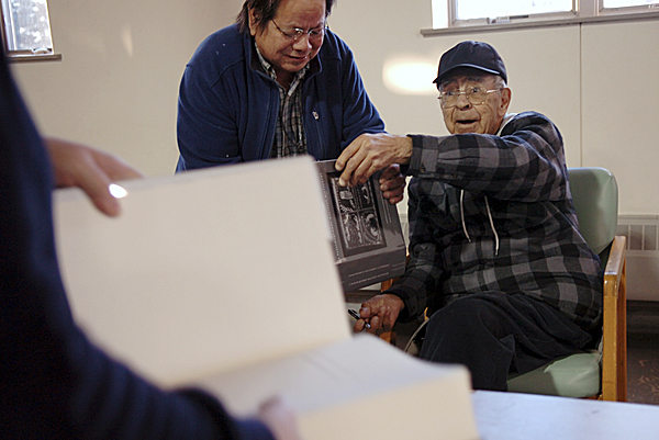 David Francis, co-author of the Passamaquoddy-Maliseet Dictionary, signs copies of the book for tribal and community members including Fredda Paul (left) on Monday at Pleasant Point.  Buy Photo