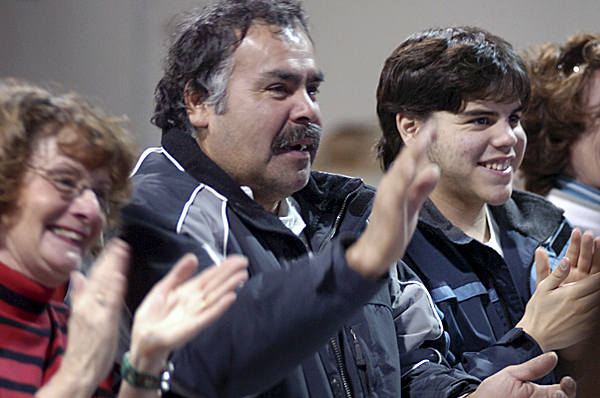 Michael Francis (center) and Jeffrey Francis, 18, the son and grandson of David Francis respectively, are among the crowd who gave him a standing ovation after speaking at the release of the Passamaquoddy-Maliseet Dictionary of which David Francis is a co-author Monday, Dec. 8, 2008 at Pleasant Point.  Buy Photo
