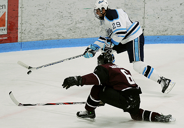 Union College's Brock Matheson (bottom) defends the net as the University of Maine's Tanner House drives the puck down the ice in the first period at Alfond Arena in Orono. Maine won 3-1.