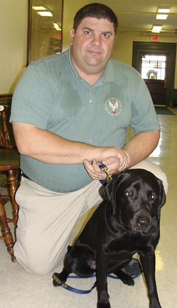 Scott Richardson and his dog Metro.