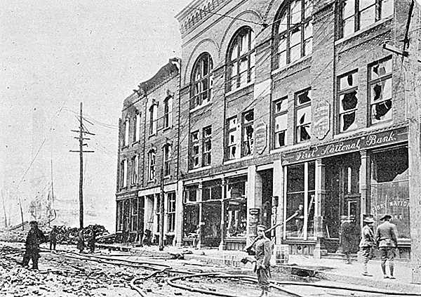 The Nichols Block on Exchange Street, where Society Hall is located on the top floor, narrowly survived the Great Fire of 1911 (aftermath pictured here) as well as urban renewal some years later.