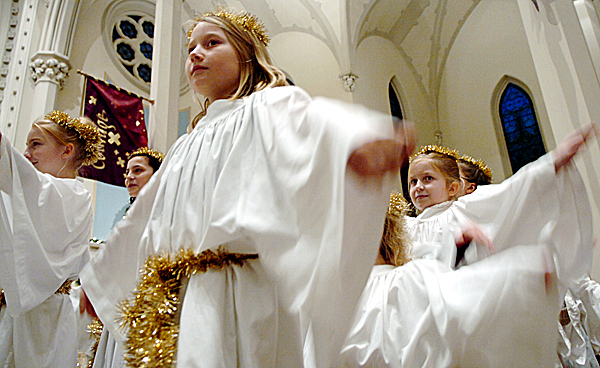 Angels including Julia Howe, 10, of Dedham (center) participate in a Christmas pageant at St. John's Catholic Church's 4 p.m. Christmas Eve Mass on Wednesday in Bangor.  Buy Photo
