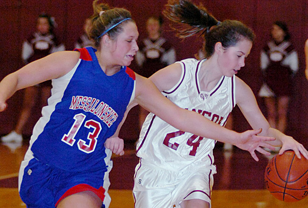 Messalonskee's Hannah Dexter (13) tries to knock the ball away from Bangor's Kate Freudenberger during the first half of Tuesday's KVAC Class A basketball game at Red Barry Gym. The Eagles of Oakland went on to win 60-49.