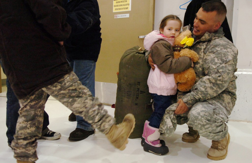 Staff Sgt. Kirk St. Peter of Caribou visits with his daughter Marienna, 4, upon his return from Iraq with Charlie Company 1-126th Aviation Regiment on Thursday, Jan. 1, 2009 in Bangor. The Maine Army National Guard medevac unit, known as the 'Black Bears,' flew more than 3,000 hours and helped evacuate 670 patients during its deployment.