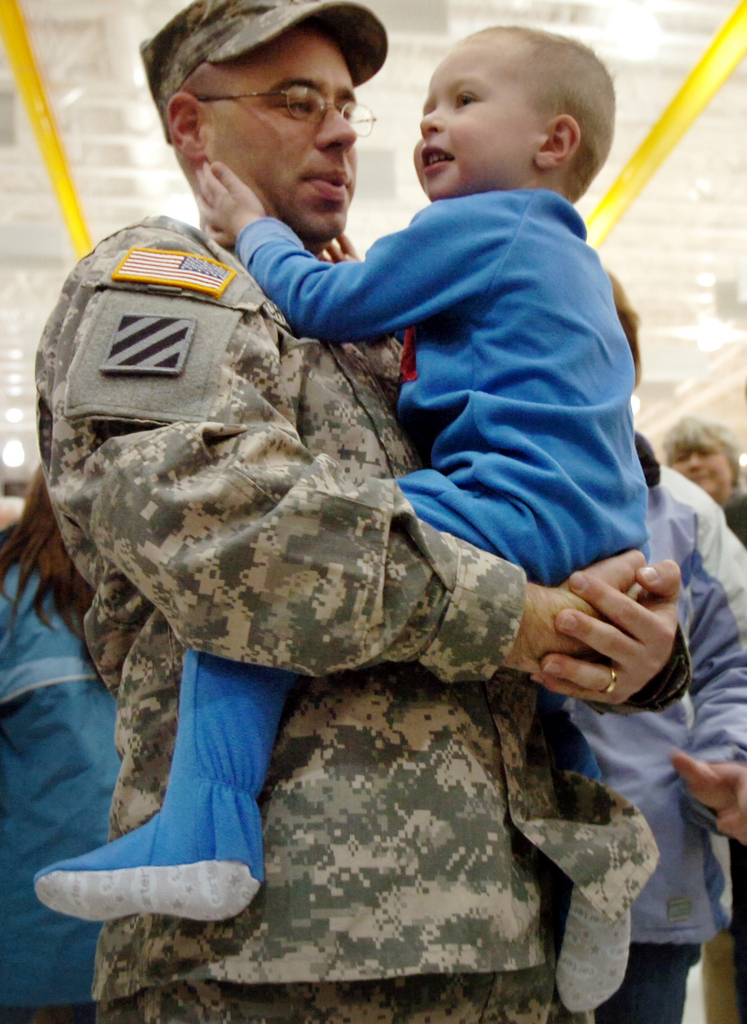 "Zakery Chadbourne, 3, was roused from his sleep early Thursday to greet his father Staff Sgt. Scott Chadbourne of Newburgh upon his return from Iraq with Charlie Company 1-126th Aviation Regiment on Thursday, January 1, 2009 in Bangor. The Maine Army National Guard medevac unit, known as the ""Black Bears,"" flew more than 3,000 hours and helped evacuate 670 patients."