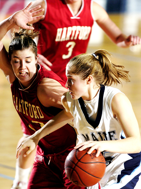 The University of Maine's Amanda Tewksbury, right, drives to the hoop with the ball against Hartford's MaryLynne Schaefer, left, during first half action on Saturday, Jan. 10, 2009 at Alfond Arena in Orono. Hartford won 77-46. Buy Photo