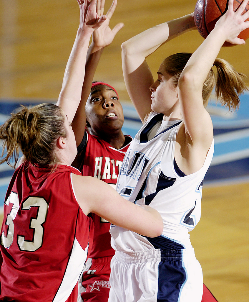 The University of Maine's Amanda Tewksbury, right, is double teamed by Hartford's Lisa Etienne, center, and MaryLynne Schaefer, left, during first half action on Saturday, Jan. 10, 2009 at Alfond Arena in Orono. Hartford won 77-46. Buy Photo
