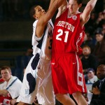 Holland leads Boston University past Nevada 66-57