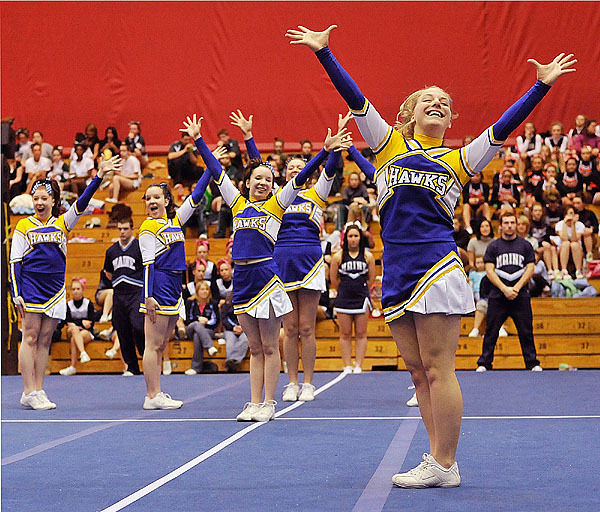 Members of the Hermon Hawks cheerleading team perform their routine at the Eastern Maine Class B championship Saturday at the Bangor Auditorium. Hermon won the title.