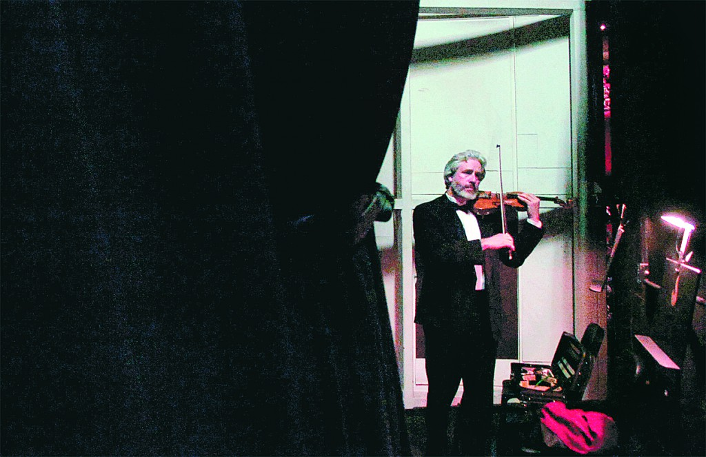 Concertmaster Trond Saeverud tunes his violin backstage before the Bangor Symphony Orchestra's performance of Beethoven's Emperor on Sunday at the Richard R. and Anne A. Collins Center for the Arts on the campus of the University of Maine in Orono. Former the Maine Center for the Arts, the symphony space opened this weekend after an extensive 18-month renovation.