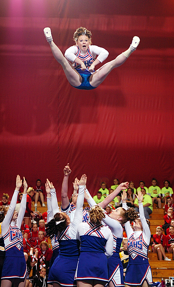The Central Aroostook High School Panthers send Brittni Mosher soaring during the Class D State Championship at Bangor Auditorium on Saturday, Feb. 7, 2009. The Panthers won the state title with 118.5 points. Buy Photo