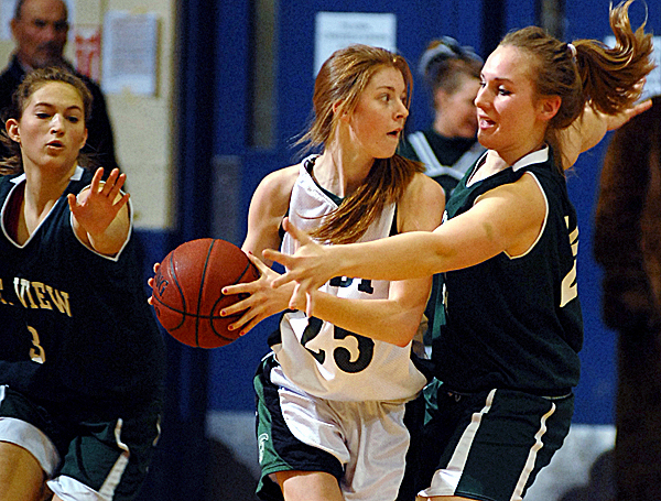 Mount View's Jessica Smith and Alexis Bennett (left) put pressure on Mount Desert Island's Jessica Swanson in the second half action of the girls Class B quarterfinal game on Saturday. Mt View won the game 34-30.